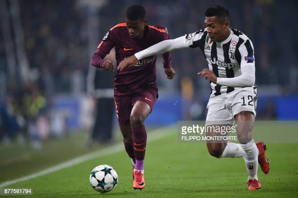 Barcelona's Portuguese defender Nelson Semedo vies with Juventus' defender from Brazil Alex Sandro during the UEFA Champions League Group D football...