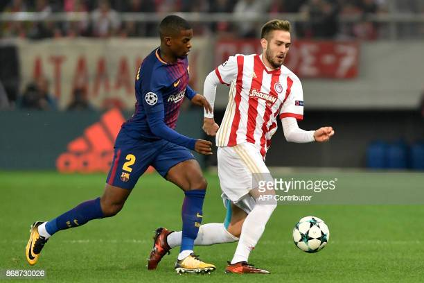 Barcelona's Portuguese defender Nelson Semedo vies with Olympiakos' Portuguese defender Diogo Figueiras during the UEFA Champions League group D...