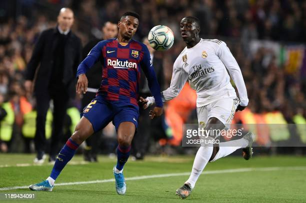 Barcelona's Portuguese defender Nelson Semedo vies with Real Madrid's French defender Ferland Mendy during the El Clasico Spanish League football...