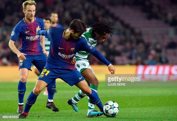 Barcelona's Portuguese midfielder Andre Gomes and Barcelona's Croatian midfielder Ivan Rakitic challenge Sporting's Portuguese forward Gelson Martins...