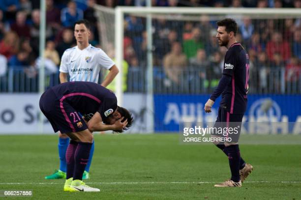 Barcelona's Portuguese midfielder Andre Gomes and Barcelona's Argentinian forward Lionel Messi stand on the field during the Spanish league football...