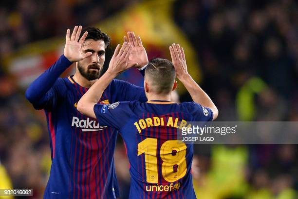 Barcelona's Portuguese midfielder Andre Gomes and Barcelona's Spanish defender Jordi Alba celebrate at the end of the UEFA Champions League round of...