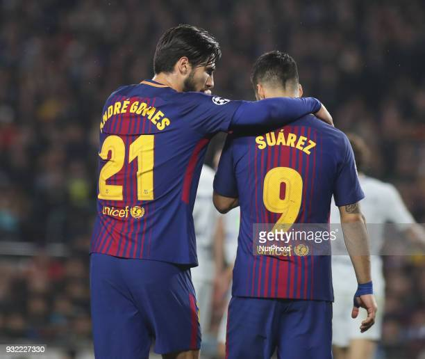 Barcelona's Portuguese midfielder Andre Gomes and Barcelona's Uruguayan forward Luis Suarez celebrate at the end of the UEFA Champions League round...