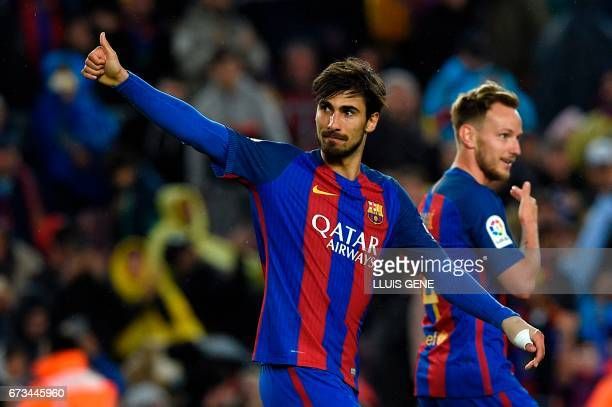Barcelona's Portuguese midfielder Andre Gomes celebrates after scoring a goal during the Spanish league football match FC Barcelona vs CA Osasuna at...