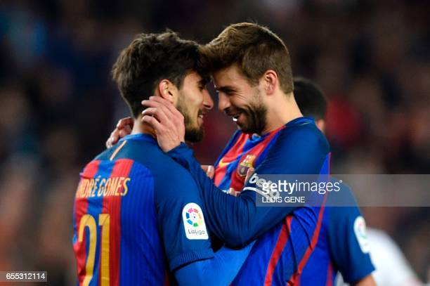 Barcelona's Portuguese midfielder Andre Gomes celebrates with Barcelona's defender Gerard Pique after scoring a goal during the Spanish league...