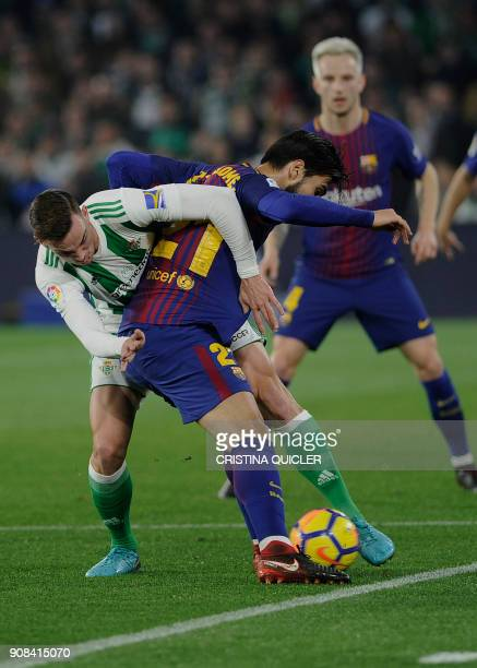Barcelona's Portuguese midfielder Andre Gomes challenges Real Betis' Spanish midfielder Fabian Ruiz during the Spanish league football match between...