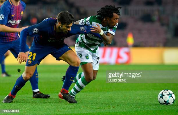 Barcelona's Portuguese midfielder Andre Gomes challenges Sporting's Portuguese forward Gelson Martins during the UEFA Champions League football match...