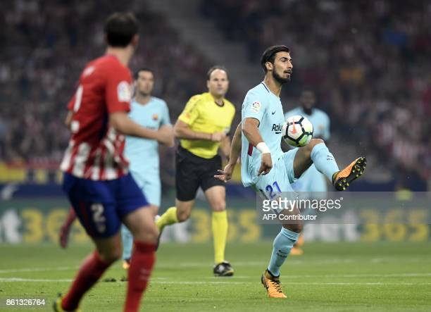 Barcelona's Portuguese midfielder Andre Gomes controls the ball during the Spanish league football match Club Atletico de Madrid vs FC Barcelona at...