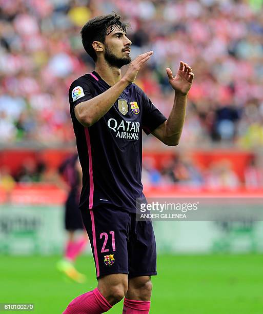 Barcelona's Portuguese midfielder Andre Gomes gestures during during the Spanish league football match Real Sporting de Gijon vs FC Barcelona at El...