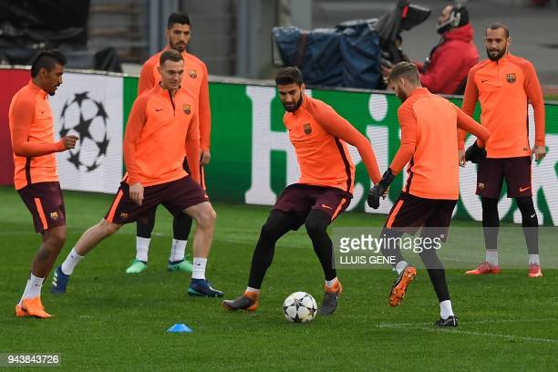 Barcelona's Portuguese midfielder Andre Gomes kicks a ball during a training session at the Olympic Stadium in Rome on April 9 2018 on the eve of the...