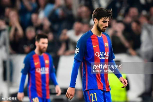 Barcelona's Portuguese midfielder Andre Gomes looks dejected at the end of the UEFA Champions League quarter final first leg football match Juventus...