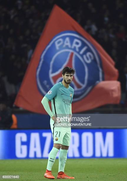 Barcelona's Portuguese midfielder Andre Gomes reacts during the UEFA Champions League round of 16 first leg football match between Paris...