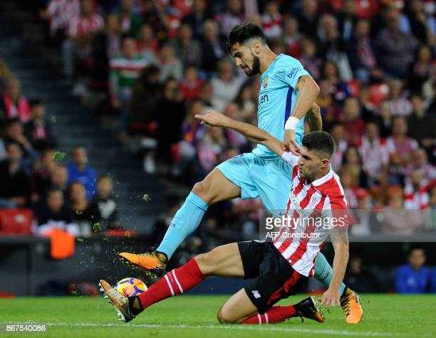 Barcelona's Portuguese midfielder Andre Gomes vies with Athletic Bilbao's Spanish defender Unai Nunez during the Spanish league football match...
