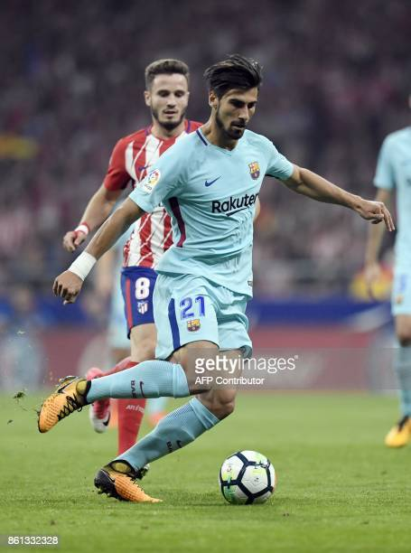 Barcelona's Portuguese midfielder Andre Gomes vies with Atletico Madrid's Spanish midfielder Saul Niguez during the Spanish league football match...