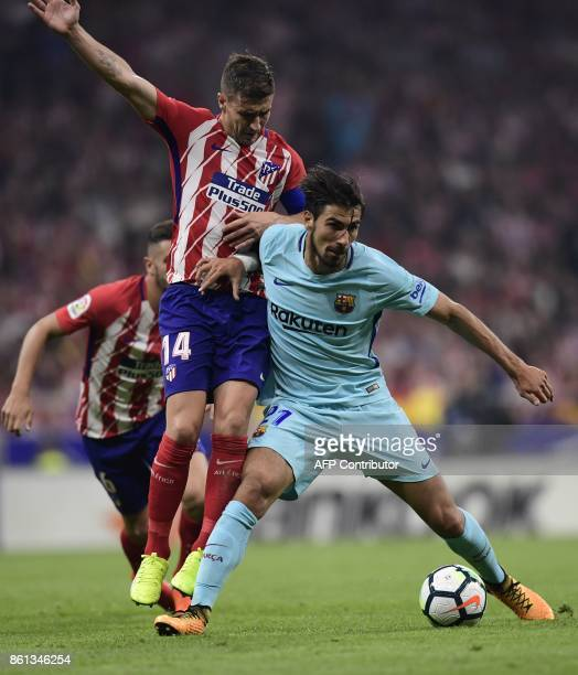 Barcelona's Portuguese midfielder Andre Gomes vies with Atletico Madrid's Spanish midfielder Gabi during the Spanish league football match Club...