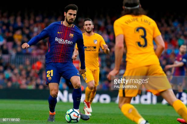 Barcelona's Portuguese midfielder Andre Gomes vies with Atletico Madrid's Brazilian defender Filipe Luis during the Spanish league football match FC...