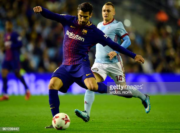 Barcelona's Portuguese midfielder Andre Gomes vies with Celta Vigo's Slovak midfielder Stanislav Lobotka during the Spanish Copa del Rey football...