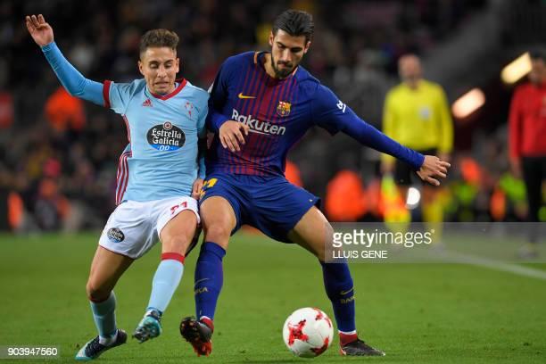 Barcelona's Portuguese midfielder Andre Gomes vies with Celta Vigo's TurkishDanish forward Emre Mor during the Spanish Copa del Rey round of 16...