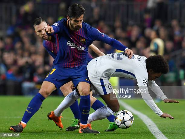 Barcelona's Portuguese midfielder Andre Gomes vies with Chelsea's Brazilian midfielder Willian during the UEFA Champions League round of sixteen...
