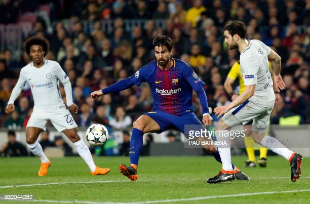 Barcelona's Portuguese midfielder Andre Gomes vies with Chelsea's Spanish midfielder Cesc Fabregas during the UEFA Champions League round of sixteen...