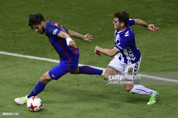 Barcelona's Portuguese midfielder Andre Gomes vies with Deportivo Alaves' midfielder Ibai Gomez during the Spanish Copa del Rey final football match...