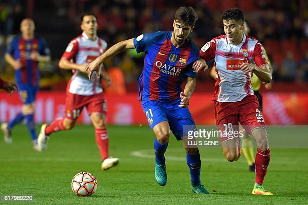 Barcelona's Portuguese midfielder Andre Gomes vies with Espanyol's midfielder Marc Roca during the Catalonia Super Copa football match FC Barcelona...