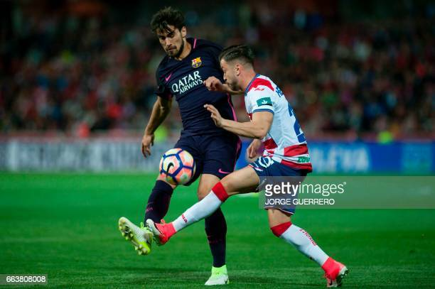 Barcelona's Portuguese midfielder Andre Gomes vies with Granada's defender Hector Hernandez during the Spanish league football match Granada FC vs FC...