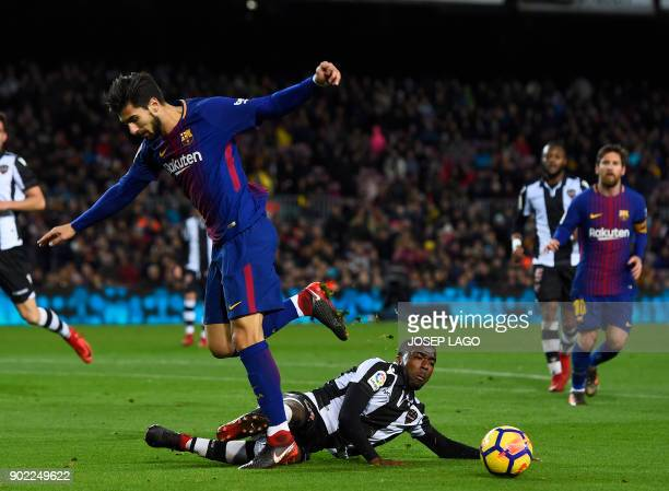 Barcelona's Portuguese midfielder Andre Gomes vies with Levante's US defender Shaq Moore during the Spanish league football match FC Barcelona vs...