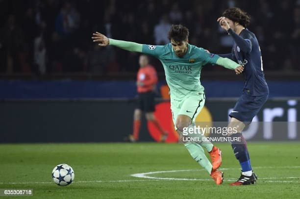 Barcelona's Portuguese midfielder Andre Gomes vies with Paris Saint-Germain's Uruguayan forward Edinson Cavani during the UEFA Champions League round...