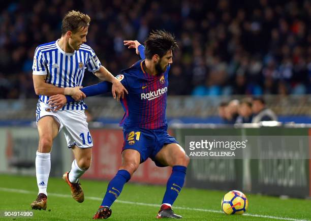 Barcelona's Portuguese midfielder Andre Gomes vies with Real Sociedad's Spanish midfielder Sergio Canales during the Spanish league football match...