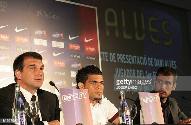 Barcelona's President Joan Laporta new signing Brasilian Dani Alves and coach Pep Guardiola give a press conference on July 2 2008 at the Nou Camp...