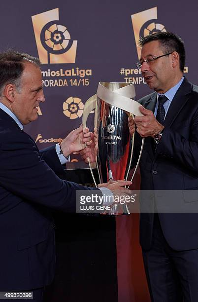 FC Barcelona's president Josep Maria Bartomeu receives from LFP's president Javier Tebas the trophy of LFP 20142015 season Best First Division Team...