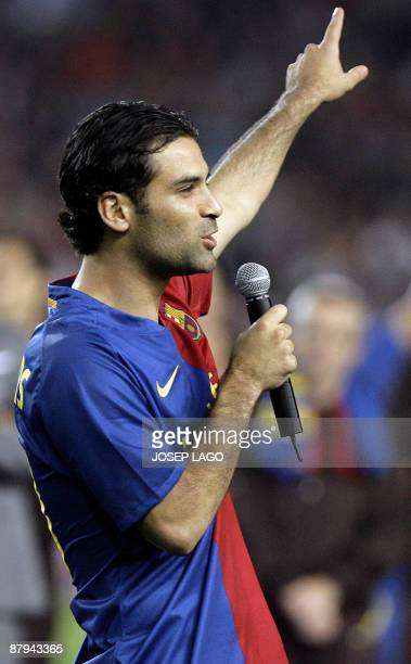 Barcelona's Rafa Marquez from Mexico speaks as the team celebrate their victory in the Spanish league title 2009 and the Spanish King's cup 2009...