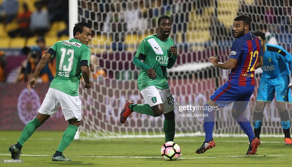 FC Barcelona's Rafinha vies for the ball with Al-Ahly's Mohamed Abdel Shafy and Mohamed Aman during a friendly football match between FC Barcelona and Saudi Arabia's Al-Ahli FC on December 13, 2016 in the Qatari capital Doha. Goals from Luiz Suarez, Lionel Messi and Neymar helped Barcelona beat Saudi champions Al-Ahli 5-3 in a thrilling friendly in Doha. The superstar trio all scored by the 17th minute, helping the Spanish giants to stroll into an early three-goal lead. JAAFAR