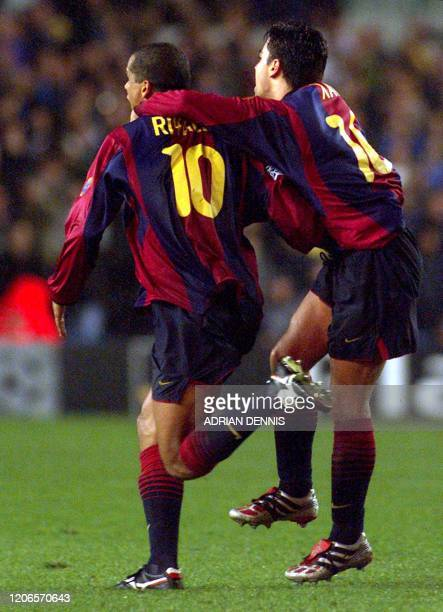 Barcelona's Rivaldo and Xavi celebrate after Rivaldo scored an equaliser shortly before the final whistle of the Champions League match against Leeds...