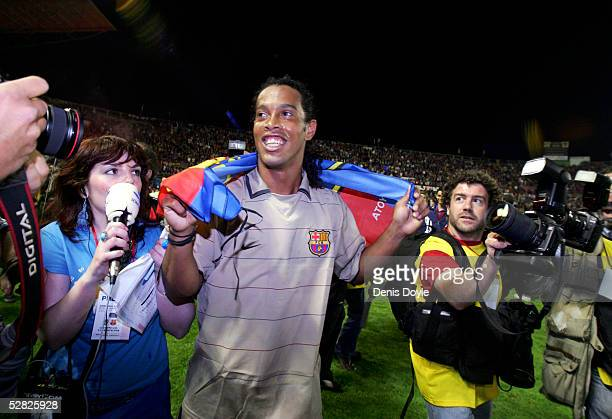 Barcelona's Ronaldinho celebrates after winning the Spanish Primera Liga title against Levante at the Ciutat de Valencia stadium on May 14 2005 in...