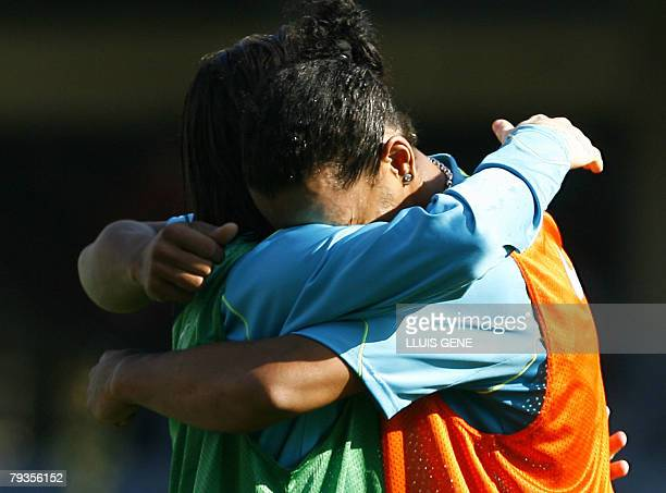 Barcelona's Ronaldinho is greeted by Argentinian Leo Messi after returning to a team training session in Barcelona 29 January 2008 Ronaldinho has not...