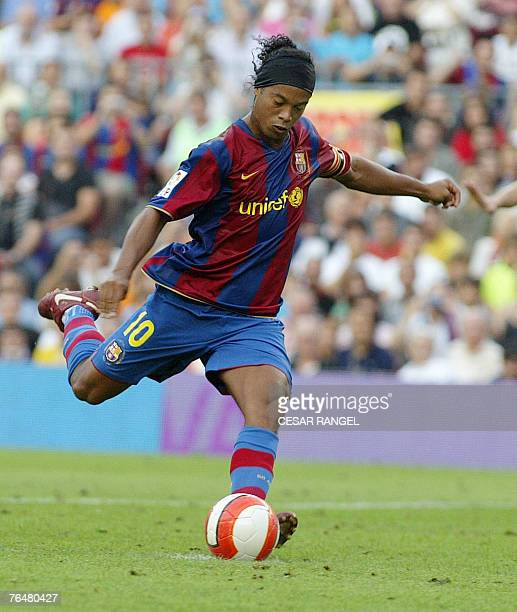 Barcelona's Ronaldinho shoots and scores from the penalty spot against Athletic de Bilbao during their Spanish league football match at the Camp Nou...
