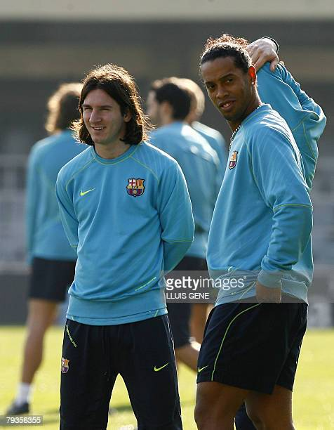 Barcelona's Ronaldinho talks with Argentinian Lionel Messi during his first team training session in Barcelona 29 January 2008 Ronaldinho has not...