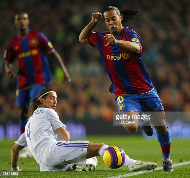 FC Barcelona's Ronaldinho vies with Madrid's Sergio Ramos during their Spanish League football match at Camp Nou stadium in Barcelona 23 December...