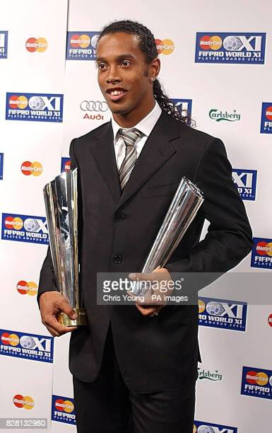 Barcelona's Ronaldino with the FIFPro World Player of the Year Award during the Mastercard FIFPro World XI Player Awards 2005 at the BBC TV Centre,...