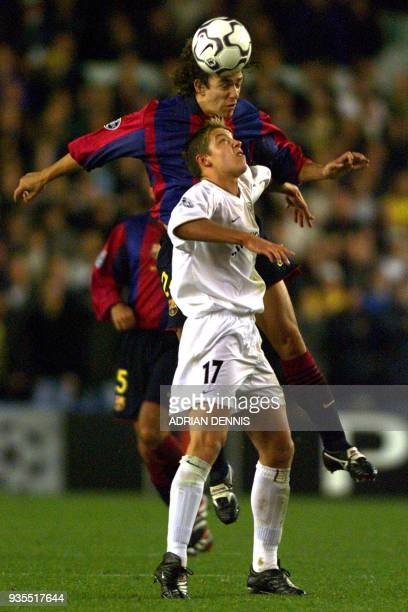 Barcelona's Sabrosa Simao beats Leeds United's Alan Smith to a header during the Champions League match at Elland Road 24 October 2000 Leeds scored...