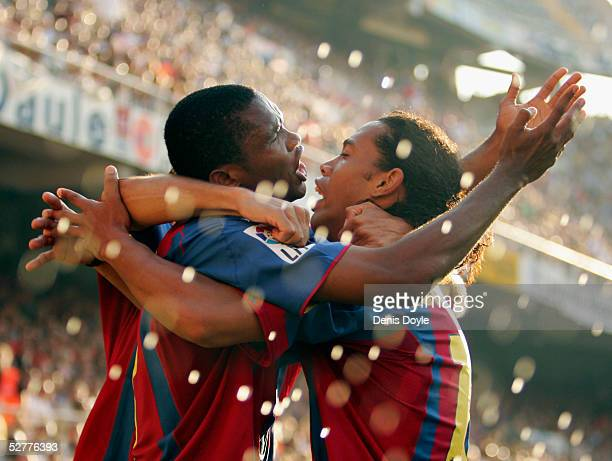 Barcelona's Samuel Eto'o celebrates with Ronaldinho after scoring a goal during a La Liga match between Valencia and Barcelona at the Mestalla on May...