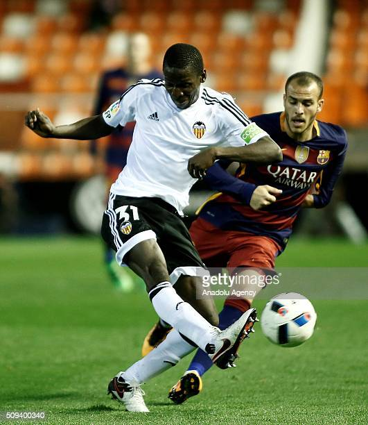 Barcelona's Sandro Ramirez and Valencia's Ibrahim Diallo vie for the ball during the Spanish Copa del Rey semifinals second leg football match...