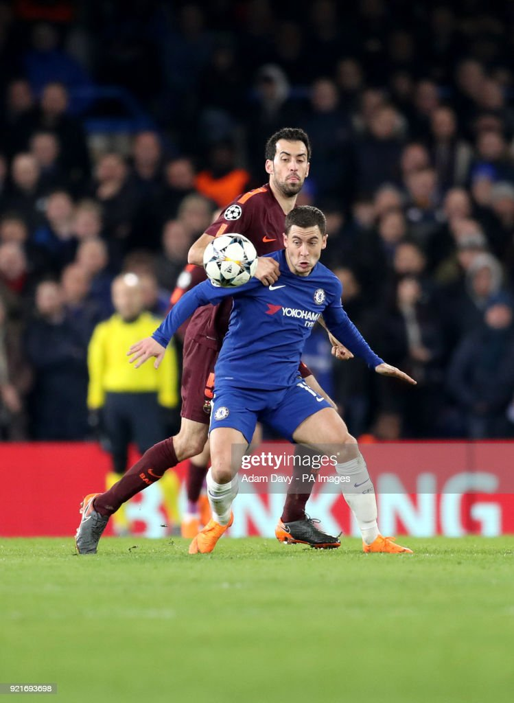 Barcelona's Sergio Busquets (left) and Chelsea's Eden Hazard battle for the ball during the UEFA Champions League round of sixteen, first leg match at Stamford Bridge, London.