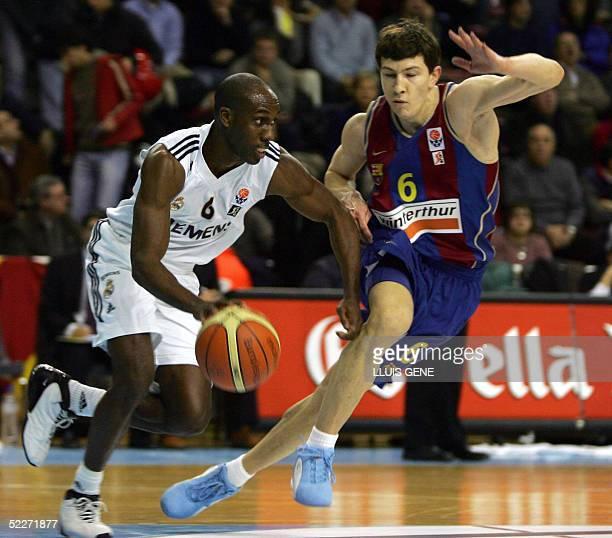 Barcelona's Slovenian Vlado Ilievski vies with Real Madrid's Elmer Bennett of EEUU in a EuroLeague basketball match at Palau Blaugrana in Barcelona...