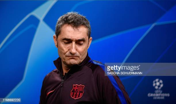 Barcelona's Spanish coach Ernesto Valverde arrives for a press conference on the eve of the UEFA Champions League Group F football match between...