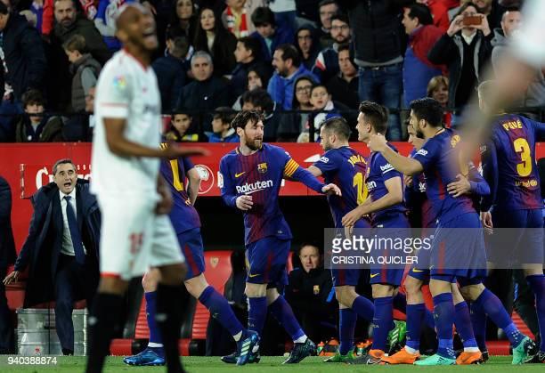 Barcelona's Spanish coach Ernesto Valverde celebrates Barcelona's Argentinian forward Lionel Messi's goal during the Spanish League football match...