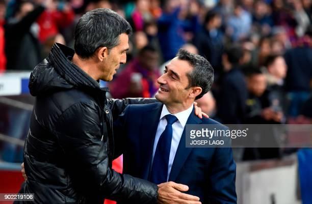 Barcelona's Spanish coach Ernesto Valverde cheers Levante's Spanish coach Juan Muniz before the Spanish league football match FC Barcelona vs Levante...