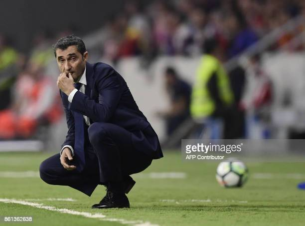 Barcelona's Spanish coach Ernesto Valverde follows the game from the sideline during the Spanish league football match Club Atletico de Madrid vs FC...